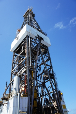 Derrick of Offshore Jack Up Drilling Oil Rig with Blue Sky