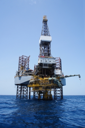 oilrig: Offshore Jack Up Drilling Rig Over The Top of Oil and Gas Production Platform