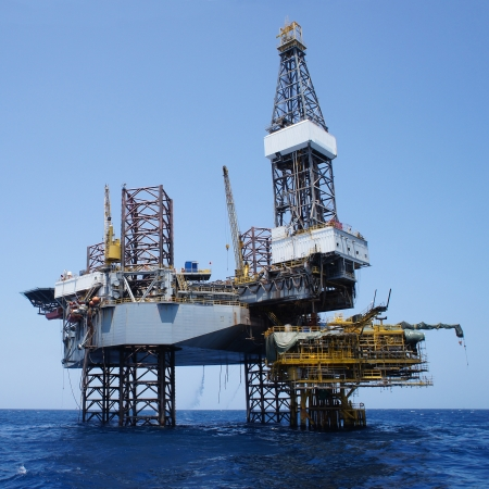 oilfield: Offshore Jack Up Drilling Rig Over The Production Platform in The Middle of The Sea - Square Shape