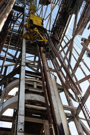 oil platform: Top Drive System (TDS) in Derrick of Oil Drilling Rig