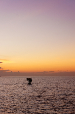 Silhouette of Offshore Production Platform in Evening Time photo