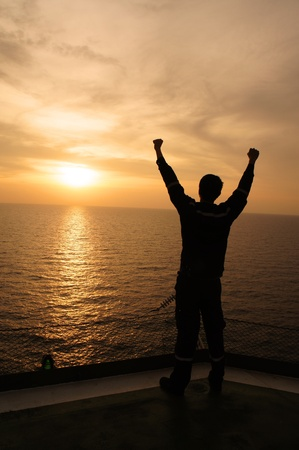Silhouette Image of Man Raising His Hands - Signs of Successful and Happiness photo