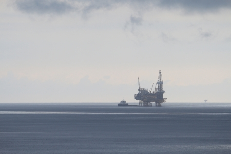 Offshore Jack Up Drilling Rig in Rainy Day photo