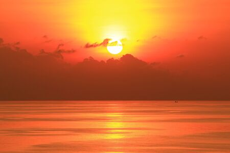 sun shine: Beautiful Sun Set in The Middle of The Ocean Stock Photo