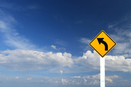 Direction sign- left turn warning on blue sky background with blank for text Stock Photo - 16766032