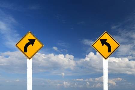 turn sign: Direction sign- left and right turn warning on blue sky background with blank for text Stock Photo