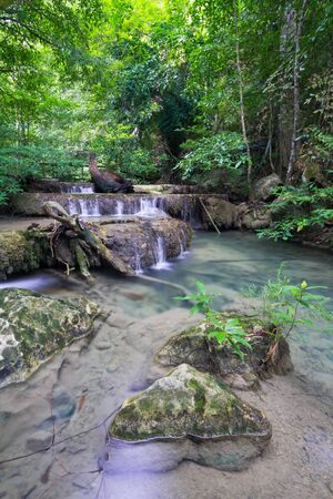 Deep forest waterfall (Erawan Waterfall) in Thailand Stock Photo - 16848920