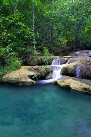 Deep forest waterfall - Erawan Waterfall  in Thailand photo