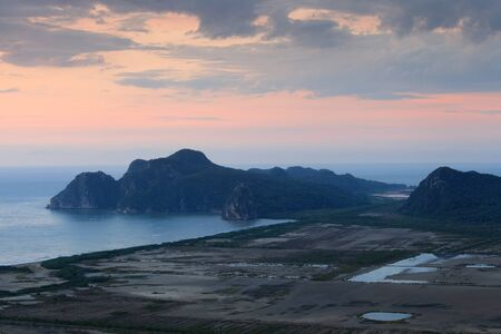 Sunrise and mountain beside the sea at  khao sam roi yot national park, Thailand photo