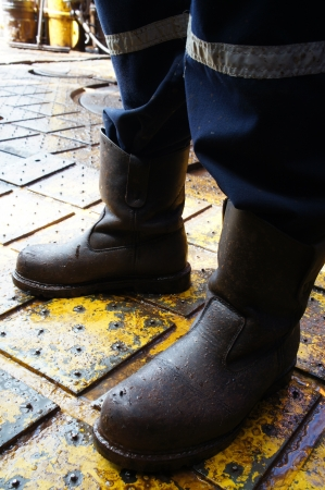 work boots: Close Up of Man Legs Standing on The Rig Floor Stock Photo