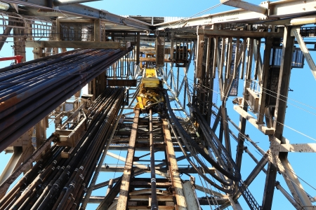 drilling platform: Oil Drilling Derrick with Top Drive, Drill Pipe, Kelly Hose For Oil and Gas Exploration  Stock Photo