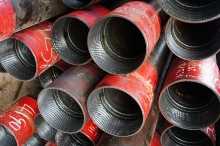 casing: Stack of oil well intemediate casing bundles at box end of casing