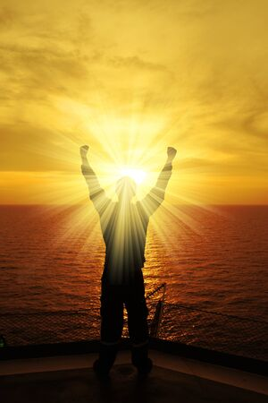 Silhouette Image of Man Raising His Hands With Ray of Light photo
