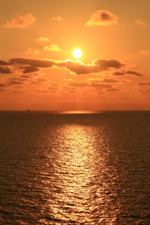 Yellow Sun Set in The Middle of The Ocean Stock Photo