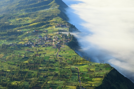 Village and Cliff at Bromo Volcano Mountain in Tengger Semeru National Park at sunrise, East Java, Indonesia