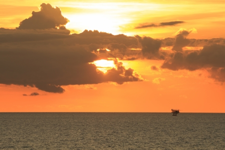 Offshore Production Platform in Sunset Time with Yellow Sky photo