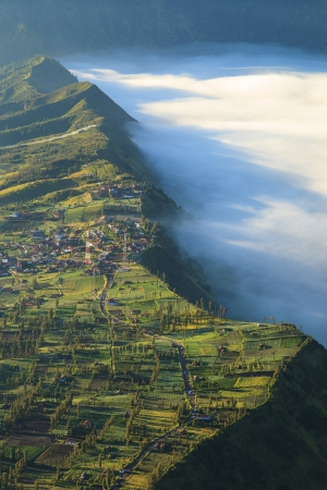 tengger: Village and Cliff at Bromo Volcano Mountain in Tengger Semeru National Park at sunrise, East Java, Indonesia