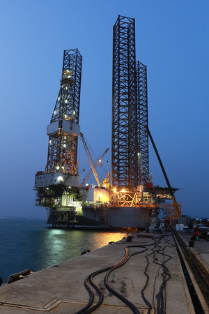 jack up: Jack up oil drilling rig in the shipyard at evening time