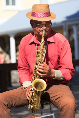 CAPE TOWN,SOUTH AFRICA-OCTOBER, 15: Old man saxophone player at Waterfront performing local music in jazz tone on October 15, 2013 in Cape Town, South Africa.
