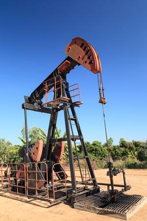 horsehead pump: Oil Pump Jack  Sucker Rod Beam  on Sunny Day Stock Photo