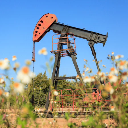 beam pump: Oil Pump Jack  Sucker Rod Beam  in The Field on Sunny Day