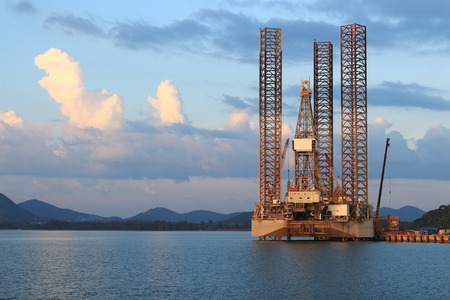 Jack up oil drilling rig in the shipyard for maintenance photo