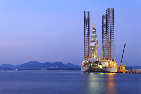 oilrig: Jack up oil drilling rig in the shipyard for maintenance at sunset time Editorial