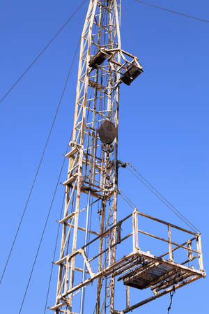 Derrick of Small Workover Rig on Sunny Day Stock Photo