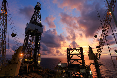 Jack Up Oil Drilling Rig At Sun Rise Time photo