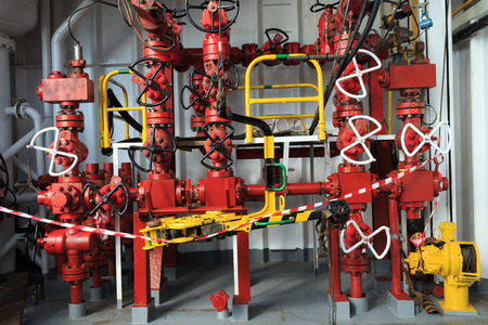 Choke Manifold and Rig Tong on Drilling Rig photo