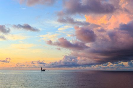 jack up: Offshore jack up drilling rig in the middle of the ocean during sunset time