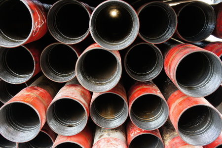wells: Stack of oil well intemediate casing bundles at box end of casing