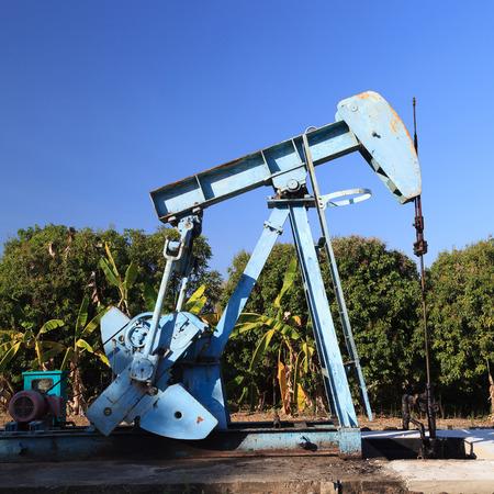 Oil Pump Jack (Sucker Rod Beam) on Sunny Day photo