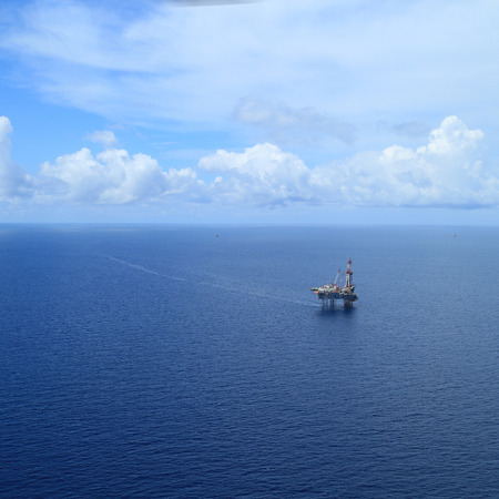 Aerial View of Offshore Jack Up Drilling Rig in The Middle of The Ocean photo
