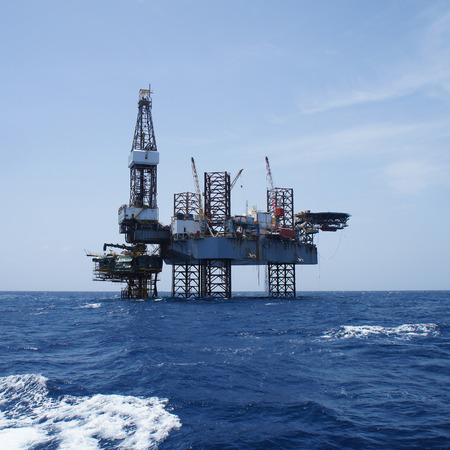 oilrig: Offshore Jack Up Oil Drilling Rig and The Production Platform in The Middle of The Ocean Working For Petroleum Development Project Editorial