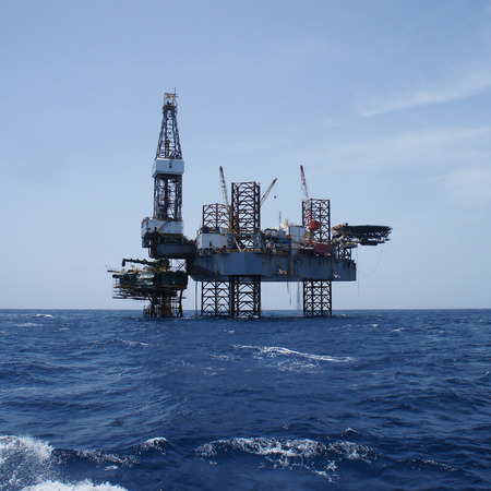 drilling platform: Offshore Jack Up Oil Drilling Rig and The Production Platform in The Middle of The Ocean Working For Petroleum Development Project Stock Photo