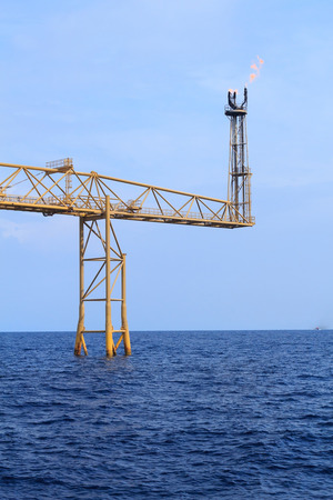 offshore jack up rig: Crew Boat and Offshore Jack Up Drilling Rig Over The Production Platform in The Middle of The Sea