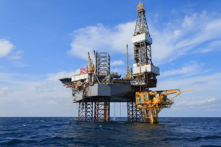 oil platforms: Offshore Jack Up Drilling Rig Over The Production Platform in The Middle of The Sea