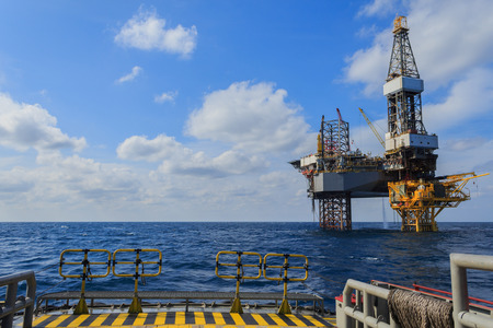 Offshore Jack Up Drilling Rig Over The Production Platform in The Middle of The Sea photo