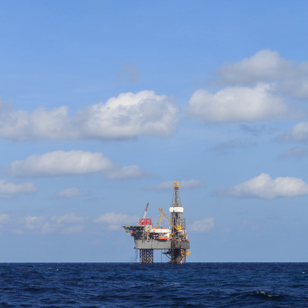 oilrig: Offshore Jack Up Drilling Rig Over The Production Platform in The Middle of The Sea
