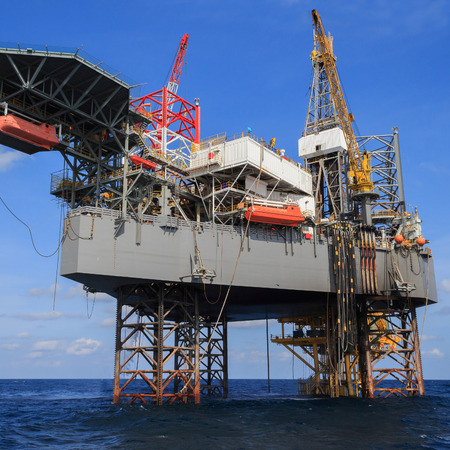 offshore jack up rig: Offshore Jack Up Drilling Rig Over The Production Platform in The Middle of The Sea