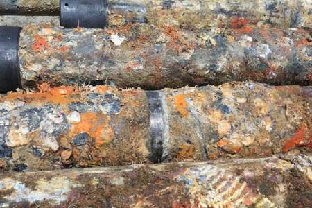 abandonment: Old surface oilfield casing just pulled out of hole from plug and abandonment operation Stock Photo