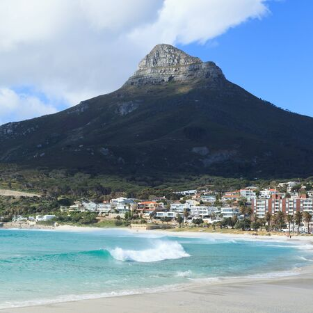 western town: Beautiful Camps Bay Beach and Lion Head Mountain Chain, Cape Town, South Africa Stock Photo