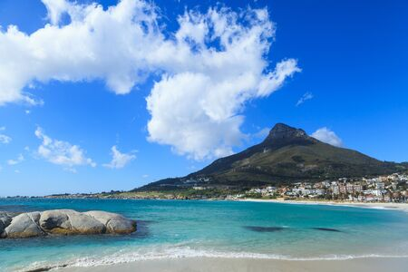 lion head: Beautiful Camps Bay Beach and Lion Head Mountain Chain, Cape Town, South Africa Stock Photo