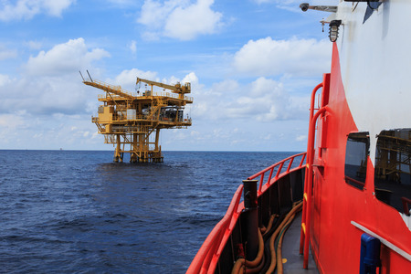work boat: Offshore Production Platform For Petroleum Development view from crew boat