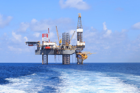 oil industry: Offshore Jack Up Drilling Rig Over The Production Platform in The Middle of The Sea