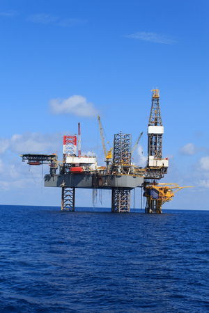oil and gas: Offshore Jack Up Drilling Rig Over The Production Platform in The Middle of The Sea