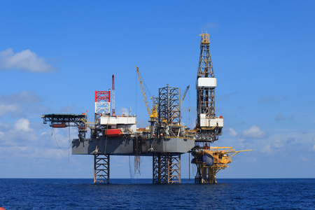crane: Offshore Jack Up Drilling Rig Over The Production Platform in The Middle of The Sea