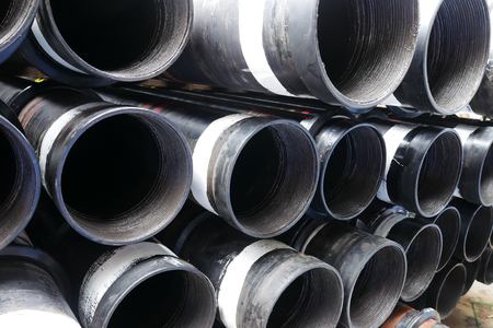 the casing: Stack of flush joint connection oil well casing (pin end) bundles Stock Photo
