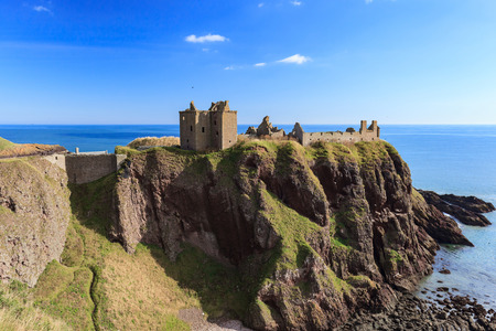 castle: Dunnottar Castle with blue sky in - Stonehaven, Aberdeen, Scotland UK